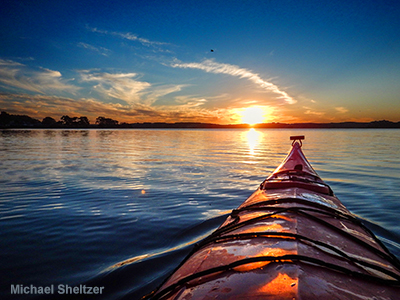 Kayaking into the sunset on Morro Bay